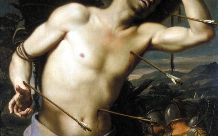 Imagem de Sebastião, sem camisa, com duas flechas no corpo. ao lado tem um soldado romano.